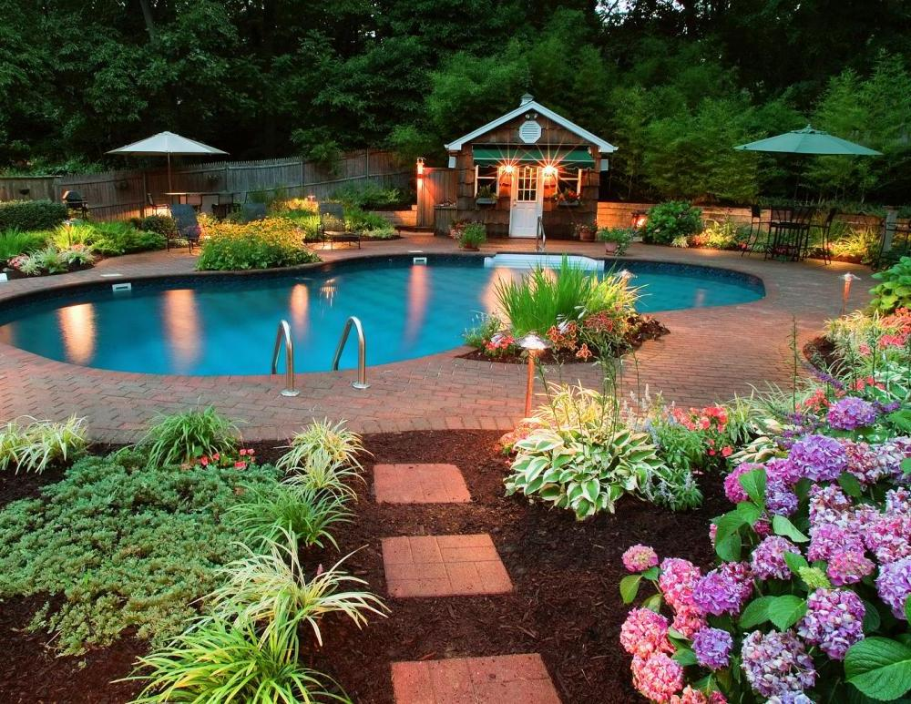 A stunning and unique swimming pool design will take your backyard oasis to the next level for entertaining.