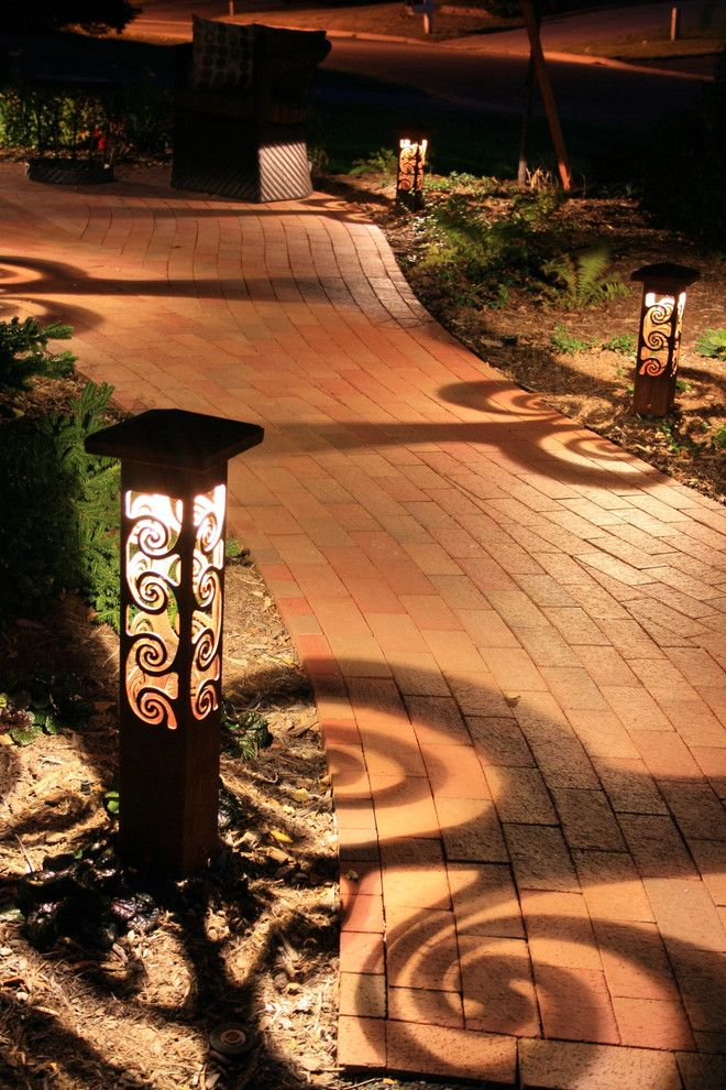 Let the experts at Milestone light up your property long after the sun goes down with creative landscape lighting ideas.